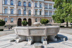 Fountain in front of Maribor secondary school building, Slovenia royalty free stock photography