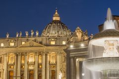 St. Peter`s Basilica on a St. Peter`s Square in Vatican at night royalty free stock image