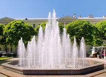 The fountain in the garden. In front of large building Stock Photos