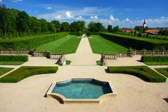 Fountain and garden. Fountain in an English-French garden Royalty Free Stock Images