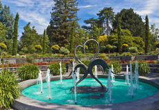 Fountain in the garden. Fountain in a garden on the island of Mainau, Germany. Mainau is maintained as a garden island and a model of excellent environmental royalty free stock photo
