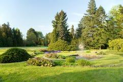 Fountain in the garden. Small fountain in botanic garden royalty free stock photos