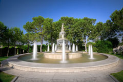 Fountain in the Garden. A fountain with a statue in a elegant garden stock images