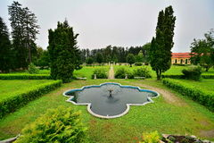 Fountain in the garden of the  Brukenthal Castle from Avrig. Castle Brukenthal from Avrig, Sibiu county, Transylvania, Romania was built in 1760 by Baron Samuel Stock Photo