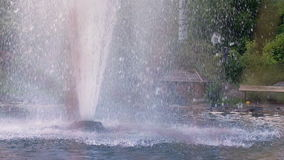 Fountain in garden. Closeup of water pouring from fountain outdoor stock video
