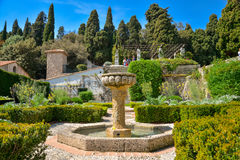Fountain at garden Franciscan monastery. Nice, France - April 12, 2017: Fountain at garden Franciscan monastery on the hill of Cimiez in Nice, France stock image