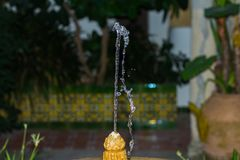Fountain in a garden of a house. The term source, which comes from the Latin fons, has different uses. The word is, for example, linked to water: a spring is the royalty free stock photo