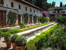 Fountain in the garden. Jardines Nazaries in the Alhambra Palace, Granada, Spain Stock Image