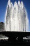 Fountain gleams in the sun. As the sun shines through the jets Royalty Free Stock Photos