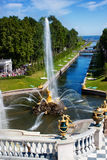 Fountain and golden statues in Peterhof Royalty Free Stock Image