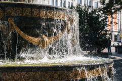 Fountain with with golden stucco and freeze water drops. Cascade fountain with with golden stucco. Freeze water drops close up Stock Image