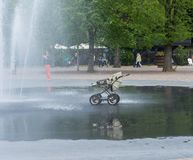 Fountain and a baby tram in a graden at gothenburg, Sweden in Spring royalty free stock photo