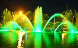 Fountain in green. Beautiful fountain in green shot during the night Royalty Free Stock Photography