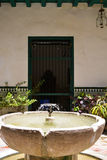 Fountain. In green colonial house courtyard stock photo
