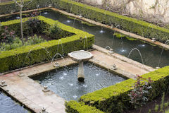 Fountain in green generalife garden park in alhambra Royalty Free Stock Image