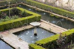 Fountain in green generalife garden park in alhambra. Water fountain in green generalife garden park in alhambra royalty free stock image