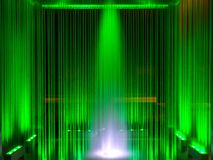 Fountain, green illuminated flowing water by night, abstract, background Stock Image