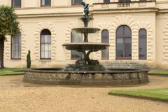 Fountain in the grounds of Osborne House. Osborne House is a former royal residence in East Cowes, Isle of Wight, United Kingdom. The house was built between stock image