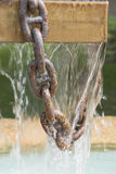 Fountain gushing with chain Royalty Free Stock Photo