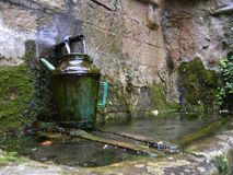 A fountain in herault, languedoc, france. A source in herault, a department of the region Languedoc, france stock photography