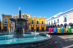Fountain in Historic Puebla. Fountain, theater, and Puebla sign in historic Puebla, Mexico royalty free stock images