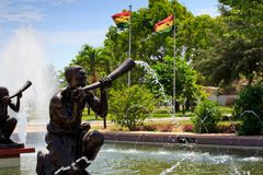 Fountain, hornblowers and flags Stock Image