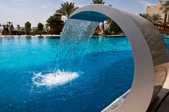 Fountain at hotel pool. Beautifully designed fountain at the hotel pool Stock Photography
