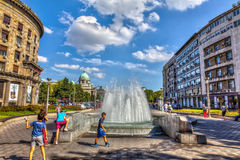 Fountain house syndicate. SERBIA, BELGRADE - JULY 26: Fountain and Serbian Parliament on July 26, 2017 in Belgrade Stock Photo