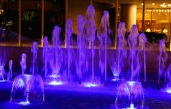 Fountain illuminated in blue Stock Photos
