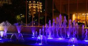 Fountain illuminated in blue Royalty Free Stock Photos