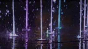 Fountain Illumination and Water Blow. In Slow Motion. Lights at Night stock video footage
