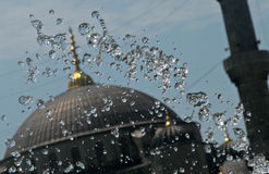 Fountain in Istanbul over Hagia Sofia. Beautiful fountain crests and flows over the Hagia Sofia in Istanbul, Turkey Royalty Free Stock Image