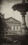 Fountain in Jackson Square Park, New Orleans. Sepia toned fountain dripping with cool water, Jackson Square Park, New Orleans, Louisiana with historical building royalty free stock image