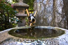 Fountain in japanese garden in Monte Carlo Royalty Free Stock Photo