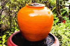 Fountain jar in home garden Stock Photos