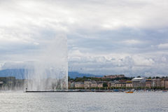 A fountain Jet d  Eau rises over the waterfront of Lake Geneva Stock Images