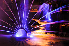 Fountain jet of fluid ejected upward from the pipe holes or the. Pressure force. Lumiere fountain. rhythmic light effects Royalty Free Stock Image