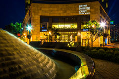 Fountain and the John Hopkins Carey Business School at night in Royalty Free Stock Images