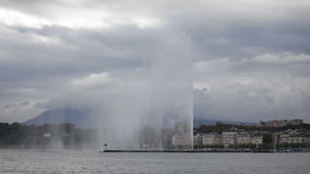 Fountain on Lake Geneva shore in cloudy day Stock Image