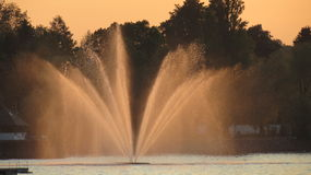 Fountain. Lake fountain spraying at sundown in lake Constance Royalty Free Stock Photo