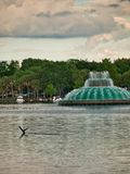 Fountain in the lake which is in the park royalty free stock photography