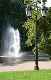 Fountain and lantern. In park Stock Photos