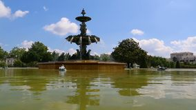 Fountain in Le jardin du Mail in Angers France. From water level on a warm summer day stock video footage