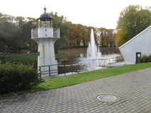 Fountain and lighthouse. Small, decorative lighthouse and fountain in the park Royalty Free Stock Photography
