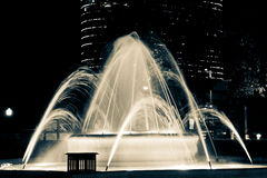 Fountain with Lights in Dallas Fort Worth Motion Blur. Fountain in Dallas Fort Worth at Night. Modern Building in background. Fountain with lighting. Motion blur stock photo