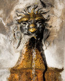 Fountain with lion face. Bronze fountain with lion face Royalty Free Stock Photo