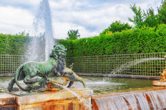 Fountain with lions in a beautful and Famous Gardens of Versaill Royalty Free Stock Photo