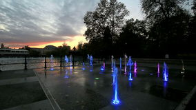 Fountain lit with rainbow colors stock video footage