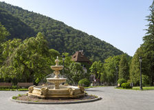 The fountain located in front of Sinaia Casino with a view towards the city Royalty Free Stock Image
