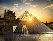 Fountain of Louvre. PARIS, FRANCE - AUGUST 30, 2016. Fountain near glass pyramid of Louvre at sunny sunrise in Paris, France Stock Photo